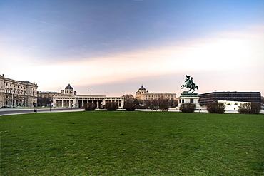Sunrise over historic buildings and gardens of Heldenplatz (Heroes' Square), Vienna, Austria, Europe