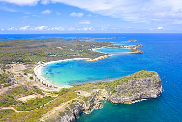 Aerial view by drone of cliffs surrounding Half Moon Bay washed by Caribbean Sea, Antigua, Leeward Islands, West Indies, Caribbean, Central America