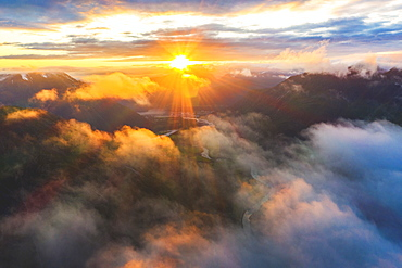 Aerial view of sun rays at sunset lighting up the clouds over Romsdalen valley, Andalsnes, More og Romsdal county, Norway, Scandinavia, Europe