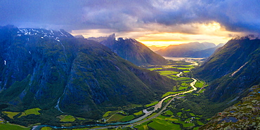 Aerial view of clouds at sunset over Romsdalen valley from Romsdalseggen ridge, Andalsnes, More og Romsdal county, Norway, Scandinavia, Europe