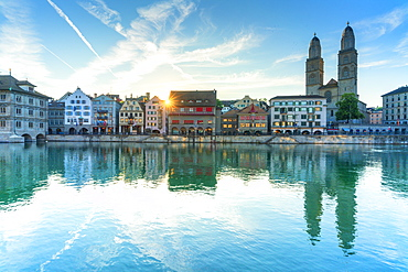 Limmatquai and Grossmunster Cathedral mirrored in Limmat River at dawn, Zurich, Switzerland, Europe