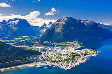 Aerial view by drone of mountains and fjord surrounding Andalsnes town, Rauma municipality, More og Romsdal county, Norway, Scandinavia, Europe