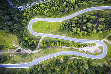 Hairpin curve of S-shape road at Maloja Pass from above by drone, Val Bregaglia, Engadine, Canton of Graubunden, Switzerland, Europe