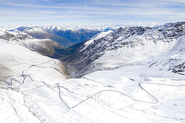 View by drone of mountain road in the snow, Giogo di Santa Maria (Umbrail Pass), Stelvio Pass, Sondrio province, Valtellina, Lombardy, Italy, Europe