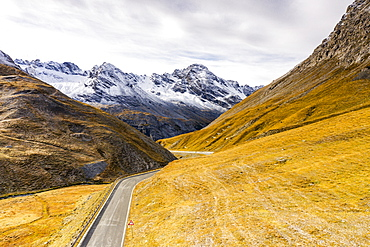 View by drone of scenic road in the autumnal landscape towards Cresta Di Reit, Braulio Valley, Bormio, Valtellina, Lombardy, Italy, Europe