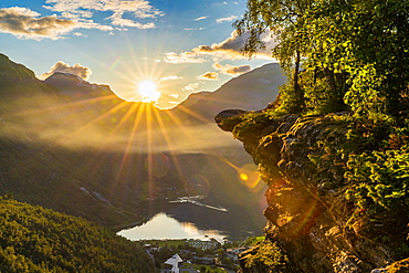 Last rays of sunset over Geiranger village and Geirangerfjord, UNESCO World Heritage Site, Stranda municipality, More og Romsdal, Norway, Scandinavia, Europe