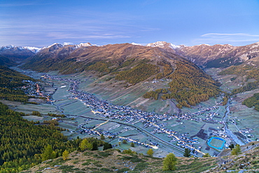 Sunrise over the village of Livigno in autumn, aerial view, Valtellina, Sondrio province, Lombardy, Italy, Europe