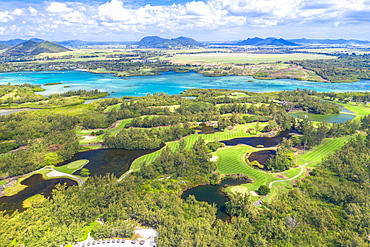 Aerial by drone of golf courses in the lush vegetation of the tropical lagoon, Ile Aux Cerfs, Flacq district, Mauritius, Indian Ocean, Africa