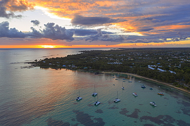 Orange sky at sunrise over the tropical beach and lagoon, aerial view, Grand Baie (Pereybere), Mauritius, Indian Ocean, Africa