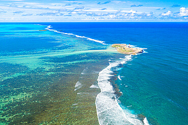 Aerial view by drone of historical island of Ile au Phare (Ile Aux Fouquets) in between coral reef and Indian Ocean, Mahebourg, Mauritius, Indian Ocean, Africa