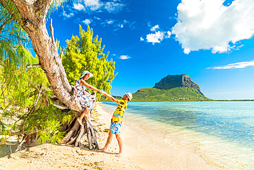 Playful man and woman in love having fun on tropical beach, Ile aux Benitiers, La Gaulette, Le Morne, Mauritius, Indian Ocean, Africa