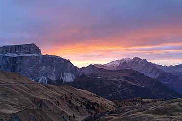 Autumn sunrise over Marmolada and Sass Pordoi from Passo Sella, Val Gardena, Dolomites, South Tyrol, Trentino-Alto Adige, Italy, Europe