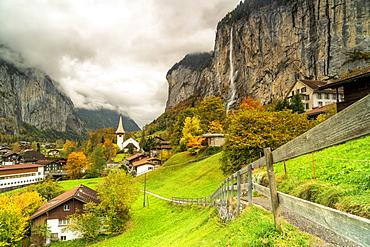 Path in the autumn landscape of Lauterbrunnen village towards Trummelbach Falls, Bern canton, Bernese Oberland, Switzerland, Europe