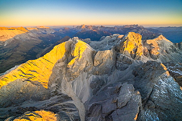 Aerial view of autumn sunset over the majestic peaks of Catinaccio Group, Dolomites, South Tyrol, Italy, Europe