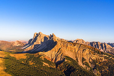 Aerial view of sunset over Seceda mountain in autumn, Cisles-Odle Nature Park, Dolomites, Val Gardena, South Tyrol, Italy, Europe