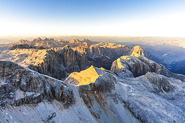 Aerial view of sunset over Sella Group and Odle mountain range in autumn, Val Gardena, Val Funes, Dolomites, South Tyrol, Italy, Europe