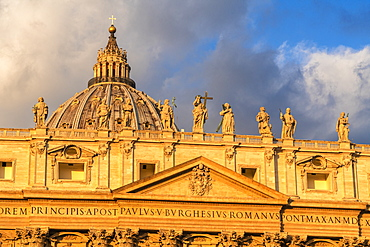 Sunrise over dome and religious holy statues of St. Peter's Basilica (Basilica di San Pietro), Vatican City, UNESCO World Heritage Site, Rome, Lazio, Italy, Europe