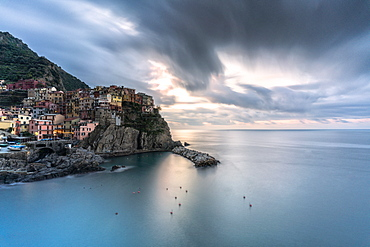 Storm clouds at sunrise over Manarola and Ligurian Sea, Cinque Terre, UNESCO World Heritage Site, La Spezia province, Liguria, Italy, Europe