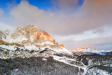 Sunrise over Monte Cristallo and Passo Tre Croci surrounded by snowy woods, Dolomites, Belluno province, Veneto, Italy, Europe