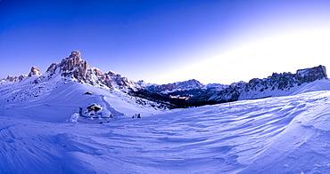 Pano of snowy Ra Gusela, Cortina d'Ampezzo, Monte Cristallo and Lastoi De Formin at dusk, Giau Pass, Dolomites, Veneto, Italy, Europe