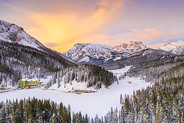 View by drone of sunset over Monte Piana and woods covered with snow, Misurina, Dolomites, Belluno province, Veneto, Italy, Europe