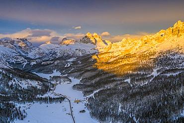 Panoramic view by drone of Tre Cime di Lavaredo and Cadini di Misurina peaks at sunset in winter, Dolomites, Belluno, Veneto, Italy, Europe