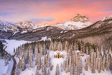 Tre Cime di Lavaredo and woods covered with snow during a winter sunset, Misurina, Dolomites, Belluno province, Veneto, Italy, Europe