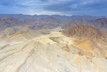 Aerial view of Oasis amidst rocks of Wadi Saba canyon, Melabday, Asso Bhole, Dallol, Danakil Depression, Afar, Ethiopia, Africa