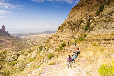 Ethiopian guides with tourists hiking to Gheralta Mountains, Tigray Region, Ethiopia, Africa