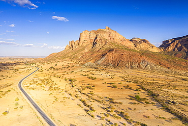 Road crossing the desert landscape of Gheralta Mountains at sunset, aerial view by drone, Hawzen, Tigray Region, Ethiopia, Africa