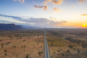Empty road across the arid landscape, aerial view by drone, Gheralta Mountains, Hawzen, Tigray Region, Ethiopia, Africa