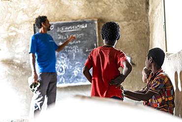 Teacher and kids in school classroom, Melabday, Asso Bhole, Danakil Depression, Afar Region, Ethiopia, Africa