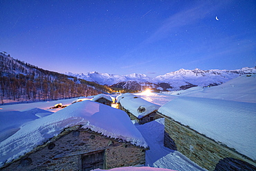 Groppera stone huts covered with snow during a starry night, Madesimo, Valchiavenna, Valtellina, Lombardy, Italy, Europe