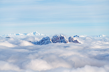 Aerial view of Monte Cristallo and Pomagagnon peaks emerging from clouds, Dolomites, Belluno province, Veneto, Italy, Europe