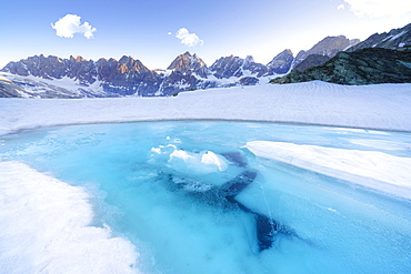 Melting ice on surface of Forbici Lake during spring thaw, Valmalenco, Valtellina, Sondrio province, Lombardy, Italy, Europe