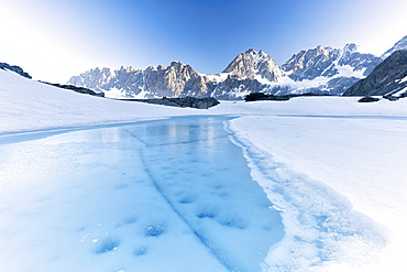 Frozen water of Forbici Lake during the spring thaw, Valmalenco, Valtellina, Sondrio province, Lombardy, Italy, Europe