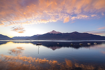 Clouds at sunrise mirrored in Lake Como, Domaso, Lombardy, Italian Lakes, Italy, Europe