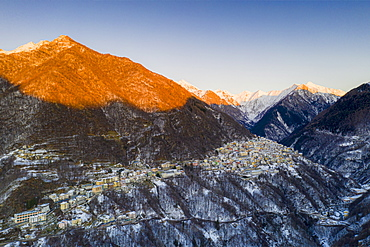 Aerial view by drone of Premana village at sunset, Valsassina, Lecco province, Lombardy, Italy, Europe