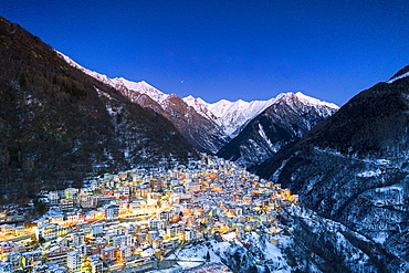 View by drone of winter dusk over the illuminated village of Premana, Valsassina, Lecco province, Lombardy, Italy , Europe