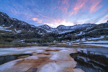 Melting ice during thaw at dawn, Alpe Fora, Valmalenco, Sondrio province, Valtellina, Lombardy, Italy, Europe