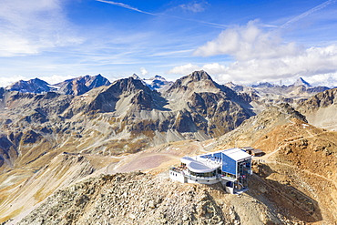 Aerial by drone of cable car station on top of the rocky peak of Piz Nair, Engadine, canton of Graubunden, Switzerland, Europe