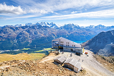 Aerial by drone of tourists at the cable car station on top of rocky peak of Piz Nair, Engadine, canton of Graubunden, Switzerland, Europe