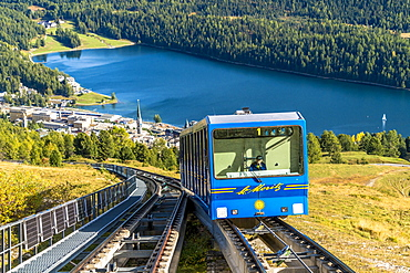 Funicular car uphill with St. Moritz lake and village in the background, Engadine, canton of Graubunden, Switzerland, Europe