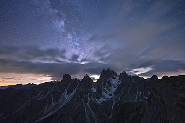 Milky Way and stars over the sharp pinnacles of Cadini di Misurina, Dolomites, Belluno province, Veneto, Italy, Europe