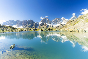 Bernina Group mountains mirrored in the clear water of Forbici lake, Valmalenco, Valtellina, Sondrio province, Lombardy, Italy, Europe