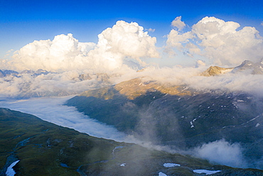 Sunlight over mountains in the fog, aerial view, Furka Pass, Canton Uri, Switzerland, Europe