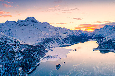 Aerial view of sunset over Lake Sils and Piz Da La Margna covered with snow, Maloja Pass, Engadine, Graubunden canton, Swiss Alps, Switzerland, Europe