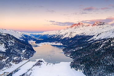 Aerial view of frozen Lake Silvaplana and Piz Corvatsch covered with snow at sunset, Engadine, Graubunden canton, Swiss Alps, Switzerland, Europe