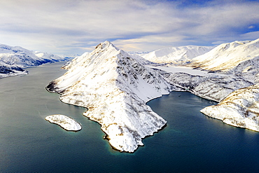 Aerial view of snow capped mountains along the clear water of Altafjord, Troms og Finnmark county, Northern Norway, Scandinavia, Europe
