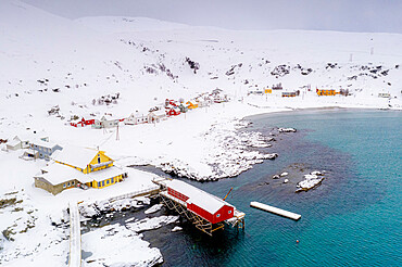 Fishing village of Sorvaer framed by the cold sea during a snowy winter, Soroya Island, Hasvik, Troms og Finnmark, Arctic, Norway, Scandinavia, Europe